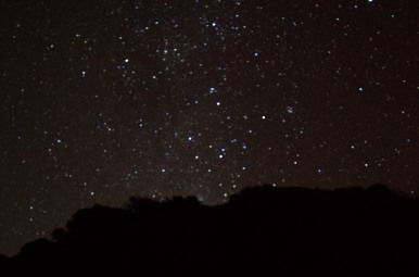 Stars against a mountain