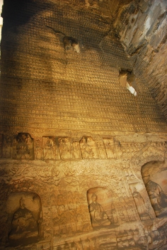 The likeness of Buddha has been carved all over this wall.