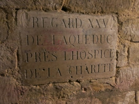 Another plaque carved in stone