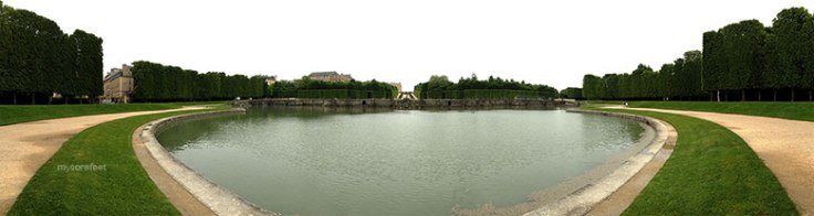 One of the many man-made lakes / fountains at the Gardens of Versailles.