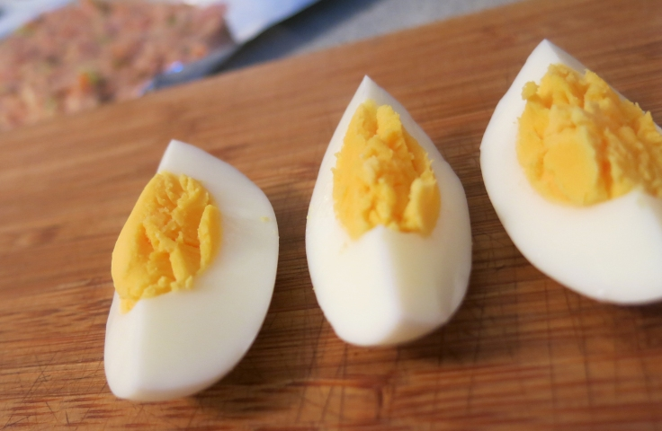 Quartered boiled eggs (see the meat mixture at the back?)